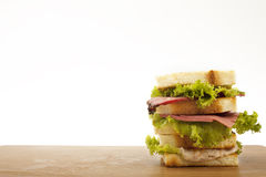Sandwich. Mix sandwich on a wooden tray Stock Image