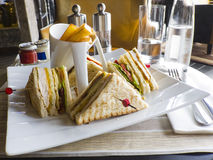 Sandwich. Served with chips on a white dish Royalty Free Stock Image