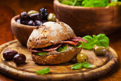 Sandwich. With Italian salami, goat cheese and fresh olives stock images