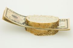Sandwich. With money, symbolising decrease in a standard of living and Stock Image
