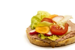 Sandwich. A bread with paste and a lot of vegetables Royalty Free Stock Image
