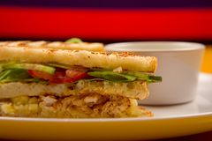 Sandwich appetizer. Grilled chicken and vegetables sandwiches with salsa dip Royalty Free Stock Photos