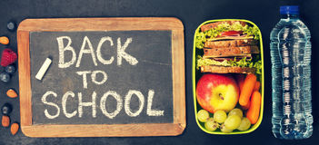 Sandwich, apple, grape, carrot, berry in plastic lunch box and b stock image
