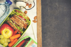 Sandwich, apple, grape, carrot, stationery and bottle of water o Royalty Free Stock Photo