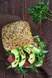 Sandwich with arugula, salami and avocado Royalty Free Stock Image