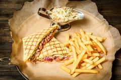 Sandwich avec des fritures Photographie stock