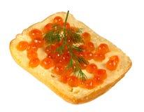 Sandwich avec le caviar rouge avec un brin d'aneth Photos libres de droits