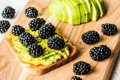 Sandwich with avocado and blackberry. healthy vegetarian food.  Stock Photo