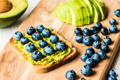Sandwich with avocado and blueberry. healthy vegetarian food.  Royalty Free Stock Photo