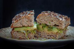 Sandwich with avocado, cheese and sprouts. Guacamole on whole grain rusk with sprouts Stock Photo