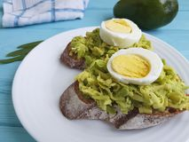 Sandwich with avocado and egg stock images
