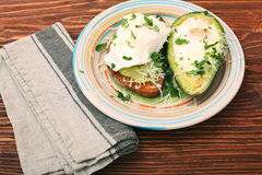 Sandwich with avocado and a fried egg Royalty Free Stock Photo