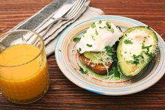 Sandwich with avocado and a fried egg Stock Photos