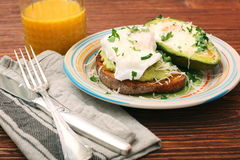 Sandwich with avocado and a fried egg Royalty Free Stock Image