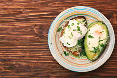 Sandwich with avocado and a fried egg Stock Photo