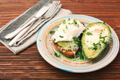 Sandwich with avocado and a fried egg Royalty Free Stock Images
