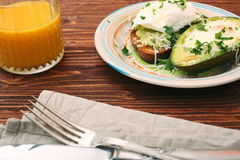 Sandwich with avocado and a fried egg Royalty Free Stock Photography