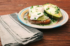 Sandwich with avocado and a fried egg Stock Image