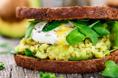 Sandwich with avocado and poached egg Royalty Free Stock Image