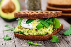 Sandwich with avocado and poached egg Royalty Free Stock Images
