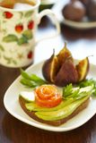 Sandwich with avocado and salmon and figs Stock Images