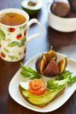 Sandwich with avocado and salmon, figs and tea Stock Images