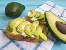 Sandwich with avocado and sesame seeds toast on a wooden. Sandwich with avocado and sesame seeds cheese toast on a wooden stock photos