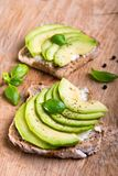 Sandwich with avocado slices and basil royalty free stock photography