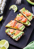 Sandwich with avocado and smoked salmon Royalty Free Stock Photo