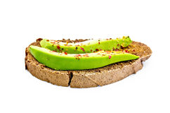 Sandwich with avocado and spices Royalty Free Stock Photo