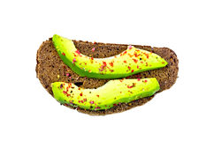Sandwich with avocado and spices on top Stock Photography