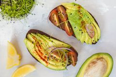 Sandwich with avocado, sprouts, tomato, light background, top vi Royalty Free Stock Photo