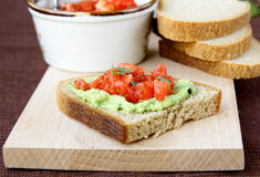 Sandwich with avocado and tomato Stock Image