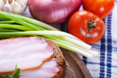 Sandwich with bacon and fresh vegetables Stock Photography