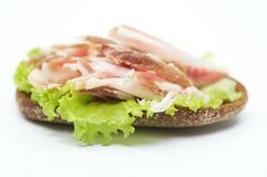 Sandwich with bacon and ham Stock Image