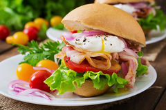 Sandwich with bacon and poached egg Royalty Free Stock Images