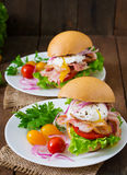 Sandwich with bacon and poached egg Royalty Free Stock Photo
