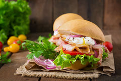Sandwich with bacon and poached egg Stock Images