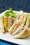 Sandwich with Bacon and Vegetables. On white plate Stock Image