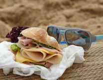 Sandwich on a beach Stock Photography