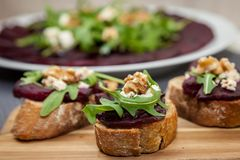 Sandwich with beetroot, beet carpaccio on the background. Healthy food royalty free stock photo