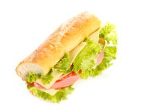 Sandwich. Big sandwich with fresh vegetables isolated on white background stock images
