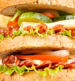 Sandwich. Big sandwich with fresh vegetables on wooden board royalty free stock photography