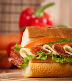 Sandwich. Big sandwich with fresh vegetables on wooden board stock photos