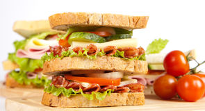 Sandwich. Big sandwich with fresh vegetables on wooden board stock photography