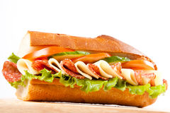 Sandwich. Big sandwich with fresh vegetables on wooden board royalty free stock image