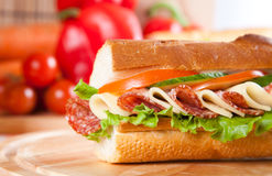 Sandwich. Big sandwich with fresh vegetables on wooden board stock image
