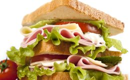 Sandwich. Big sandwich with fresh vegetables on wooden board royalty free stock photos