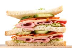 Sandwich. Big sandwich with fresh vegetables on wooden board on white background stock image