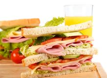 Sandwich. Big sandwich with fresh vegetables on wooden board on white background stock photos